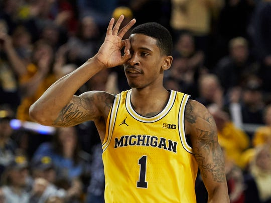 Dec 9, 2017; Ann Arbor, MI, USA; Michigan's Charles Matthews celebrates a 3-point basket in overtime of the Wolverines' 78-69 win against UCLA at Crisler Center.