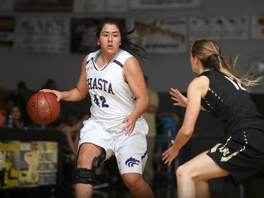 Shasta's Julianna Flores takes the ball past Del Norte's Claire Smith on Friday during the 2017 Harlan Carter Invitational.