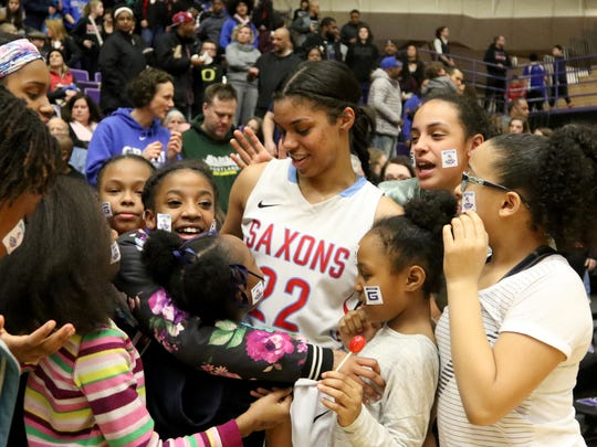 South Salem's Evina Westbrook (22) is congratulated by fans following the Grant vs. South Salem girl's basketball game to determine third place in the OSAA Class 6A State Championships at the University of Portland on Saturday, March 11, 2017. South Salem won the game 58-53.
