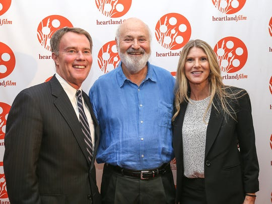 "From left, Indianapolis Mayor Joe Hogsett, ""LBJ"" film director Rob Reiner and Stephanie Hogsett pose on the red carpet on opening night of the Heartland Film Festival at the Indianapolis Museum of Art's Toby Theater, Indianapolis, Thursday, Oct. 12, 2017."