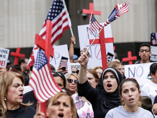 Protesters protest the arrest of more than 100 Iraqi nationals by ICE outside of the Theodore Levin United States Courthouse on June 21, 2017 in Detroit.