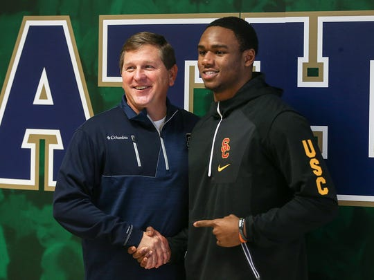 From left, coach Rick Streiff smiles for a photo with Markese Stepp, who signed a letter-of-intent to play football at University of Southern California on signing day, Cathedral High School, Indianapolis, Wednesday, Dec. 20, 2017.