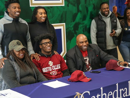 Family members pose for a photo with Hugh Davis after he signed a letter-of-intent to play football at Boston College for signing day, Cathedral High School, Indianapolis, Wednesday, Dec. 20, 2017.