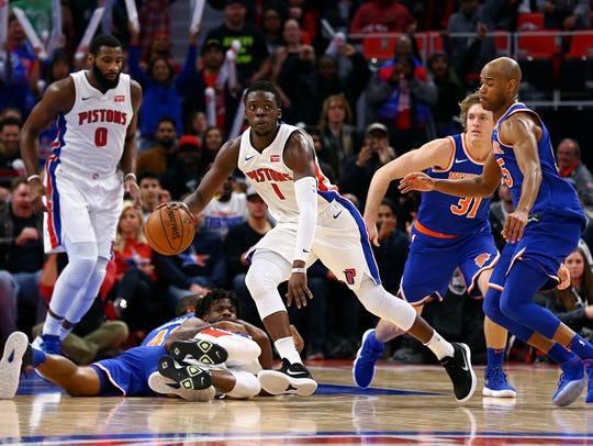 Pistons guard Reggie Jackson (1) recovers the loose