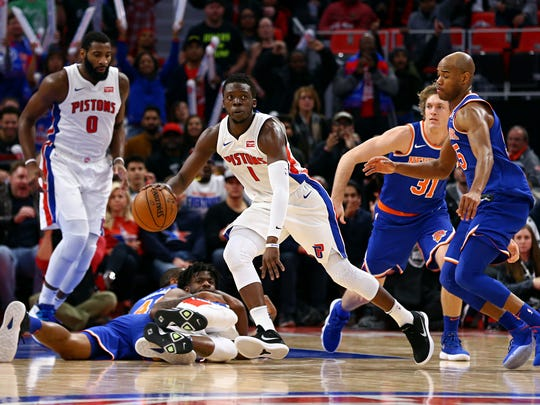 Pistons guard Reggie Jackson (1) recovers the loose ball against the Knicks in the second half of the 104-101 win over the Knicks on Friday, Dec. 22, 2017, at Little Caesars Arena.