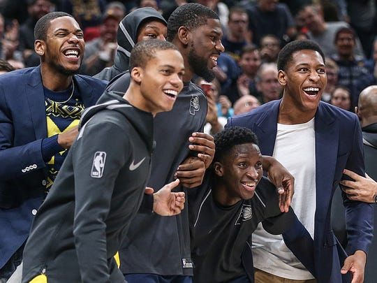 Players on the Indiana Pacers bench react during fourth quarter action between the Indiana Pacers and Brooklyn Nets at Banker's Life Fieldhouse, Indianapolis, Saturday, Dec. 23, 2017. The Pacers won in overtime, 123-119.