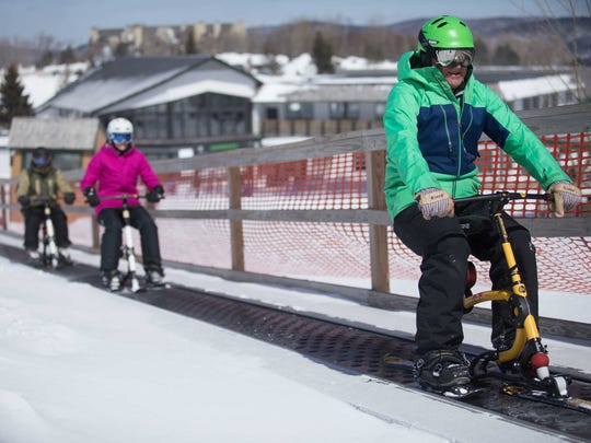 Ski bike riders get a lift up the slope at Killington