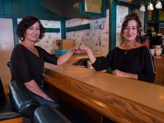 Shelly and Sheila LaCroix sit at the bar in the former