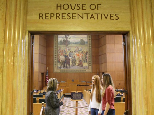 Students Marissa Dougall, right, and Kimberly Schott, center, met with Superintendent Christy Perry, left, and legislators Monday at the Oregon State Capitol.