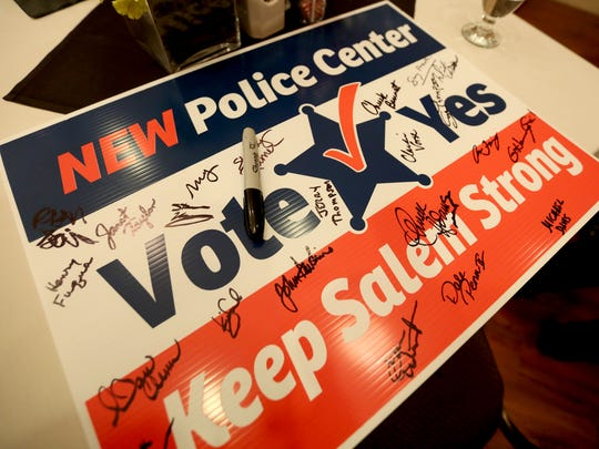 Supporters of the $61.8 million police facility bond measure sign a yard sign and gather to await election results at the Grand Hotel in downtown Salem on May 16, 2017.