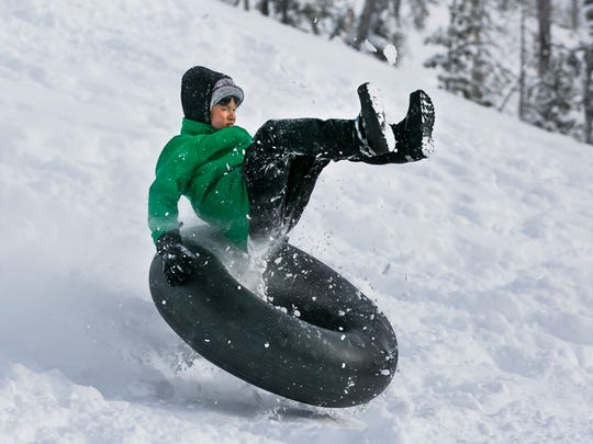 Cameron Asay flies off a ramp made out of snow at the