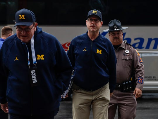 Michigan Wolverines head coach Jim Harbaugh arrives