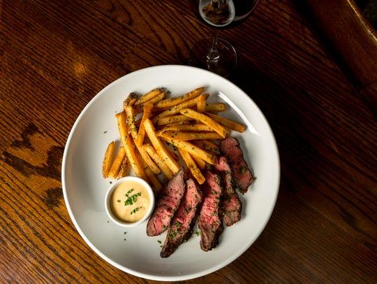 Flat iron steak frites looks basic, but has deep flavor.