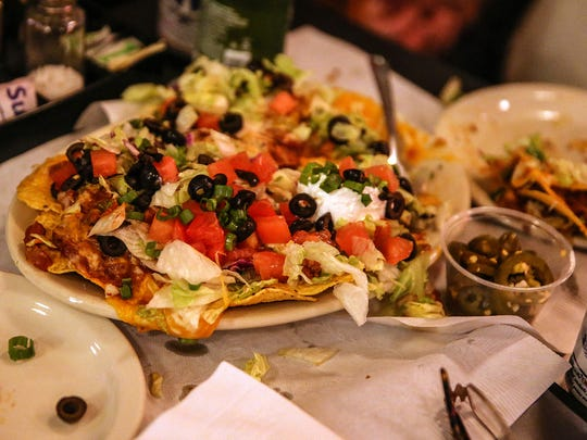 Many plates of nachos are ordered on the last night
