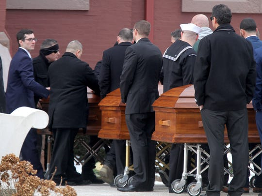 Caskets for Steven Kologi, his wife Linda and daughter Brittany leave St. Michael's Roman Catholic Church in Long Branch, NJ, after their funeral service Monday, January 8, 2018. The three were killed on New Year's Eve, along with Mary Ann Schulz, allegedly by a 16-year-old family member.