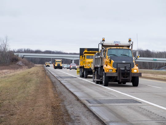 St. Clair County Road Commission trucks work on patching the westbound lanes of I-69 near Goodells Thursday.