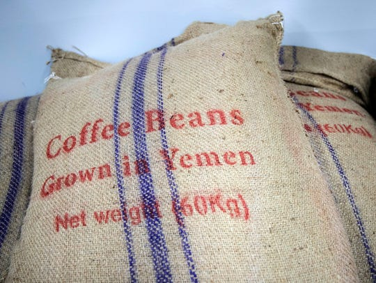Bags of Yemeni coffee beans are stored at the Qahwah