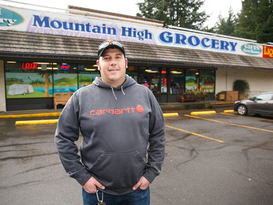 Mountain High Grocery owner Paul O'Donnell on January 12, 2018, in Detroit, Ore. O'Donnell and other local Detroit business owners are concerned about a proposal to drain the lake to build a 300-foot tower by Detroit Dam.