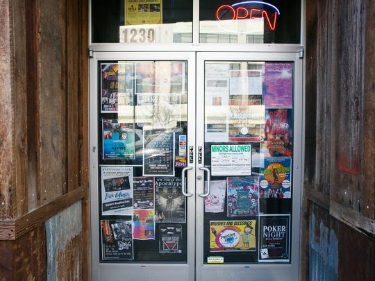 Posters for upcoming events decorate the doors of Shotskis Woodfired Eats on January 14, 2018.