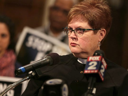 Rev. Jill Zundel talks during a press conference after