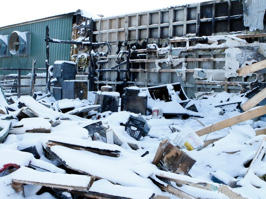 Snow blankets the debris from a Jan. 13 fire at Dettmann