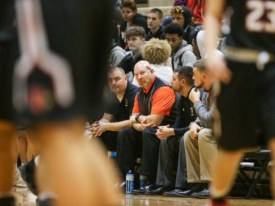 Beech Grove high School's Varsity Boys Basketball Coach Matt English, center, watches his team during a game against Southport at Beech Grove on Wednesday, Jan. 17, 2018. Beech Grove beat Southport 49 to 37.