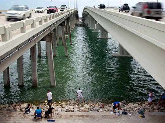 Thursday, July 5, 2012 under the Judge S.S. Jolley Bridge in Marco Island, Fla. A couple dozen fished in hopes of reeling in a big one.