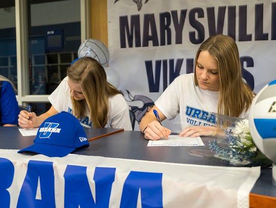 Marysville High School volleyball players Hannah, left,