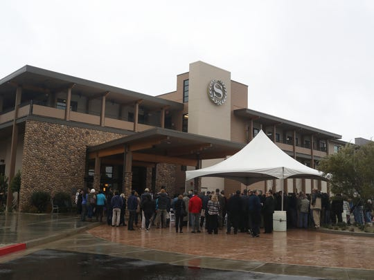 Community members gather at the opening of the Sheraton