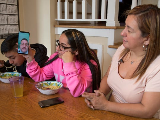 Jorge Garcia, left, slurps ramen noodles in January 2018 as his sister Soleil and his mom Cindy Garcia talk to Jorge Garcia who was deported to Mexico.