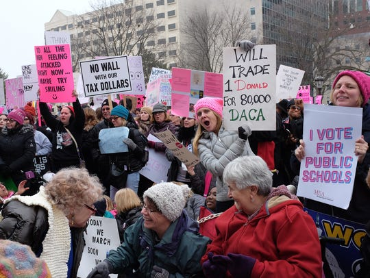 Attendees of Sunday's Women's March in downtown Lansing flooded the steps of the State Capitol where a variety of people spoke.