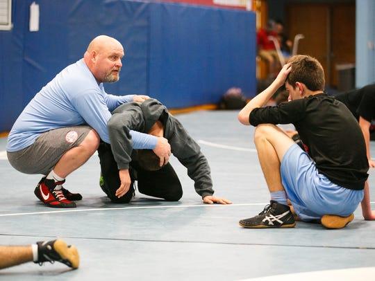 South Salem wrestling Scott DuFault works with athletes