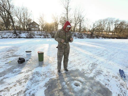 Jerry Van Dyck of Des Moines bears sub-zero temperatures