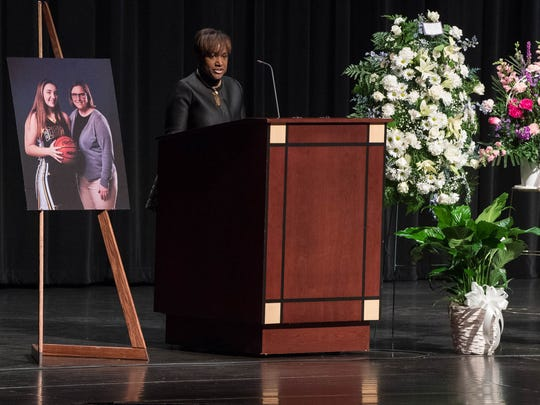 Battle Creek Superintendent Kim Carter speaks at W.K. Kellogg Auditorium for the memorial for Lori Mahar Wednesday evening.