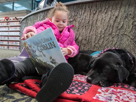 Kids can read to dogs at Paws to Read.