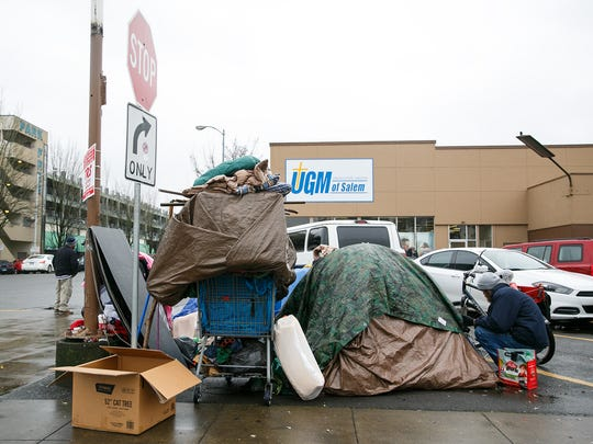 A makeshift camp in the parking lot of Union Gospel Mission on Saturday, Dec. 23, 2017, in downtown Salem.