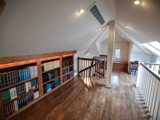 The roomy attic was turned into a third-floor library and study where ceilings  follow the slanting lines of the roof. Large skylights let light flood from the third floor down to the first.