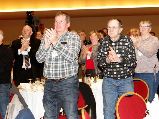Farmers applaud Governor Scott Walker after he presented