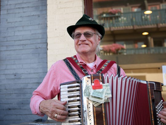 Richard Moles, 80, of Silverton, plays his accordion at the Mt. Angel Oktoberfest in Mt. Angel, on Friday, Sept. 15, 2017.