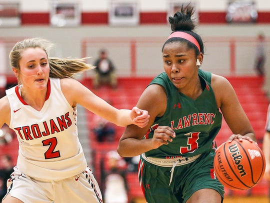 Lawrence North Wildcats Trinity Brady (3) drives past