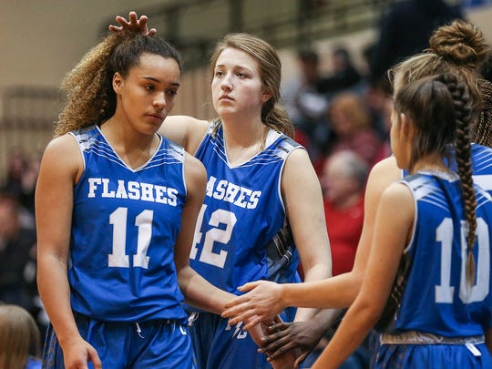 Franklin Central Flashes Rachel Loobie (11) is consoled by teammates as she shows emotion leaving the court near the end of second half action of sectionals between the Martinsville Artesians and Franklin Central Flashes, at Franklin Central High School, Indianapolis, Tuesday, Jan. 30, 2018. The Martinsville Artesians won, 57-37.