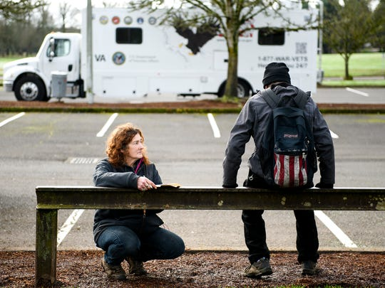 Joan, left, surveys a homeless person at Wallace Marine Park on Wednesday, Jan. 31, 2018. Joan is homeless herself and lives with the Wallace Marine community; many regard her as the camp mom.