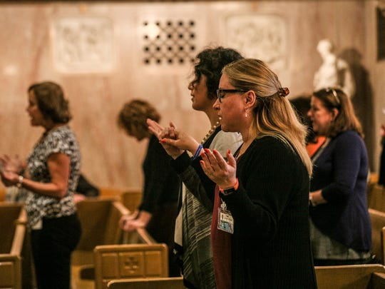 Gabriela Rodriguez, 52, of Rochester Hills holds hands with Karla Flores, 45, of Farmington during a prayer service for victims of the shooting in Las Vegas. The service was organized by the Archdiocese of Detroit on Oct. 2, 2017 at St. Aloysius church in downtown Detroit.