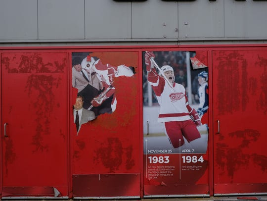 Sign are torn on doors of the Joe Louis Arena on Friday, Feb. 2, 2018, in downtown Detroit.