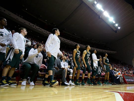 The Michigan State Spartans bench as time expires against the Indiana Hoosiers in the second half at Assembly Hall, Saturday, Feb. 18, 2018.