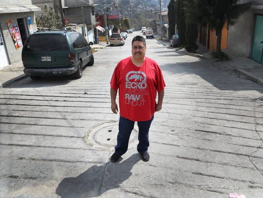 Jorge Garcia, 40, formerly of Lincoln Park, lives in Nicolás Romero, Mexico, after being deported on Jan. 15, 2018. He feels like an outsider and misses his wife and children back in Michigan. Garcia stands in the street in front of his aunt's house where he is now living. Photo from Jan. 26, 2018.
