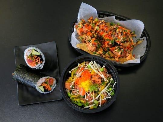 The Titan burrito, salmon poké and Japanese nachos at Yuzu Kitchen in Manalapan.  FILE PHOTO Titan burrito, Salmon Poké and Japanese nachos at Yuzu Kitchen in Manalapan, NJ Thursday March 2, 2017.
