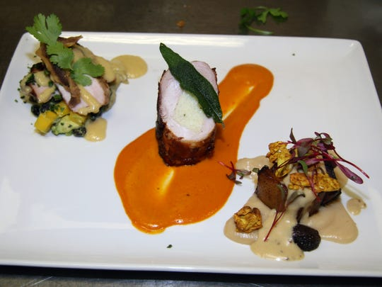 Chef Michael Bressler, of The Red Circle Inn and Bistro in Nashotah, created The Three Little Pig Plates to win  Chef Par Excellence in the Wisconsin's Taste of Elegance.