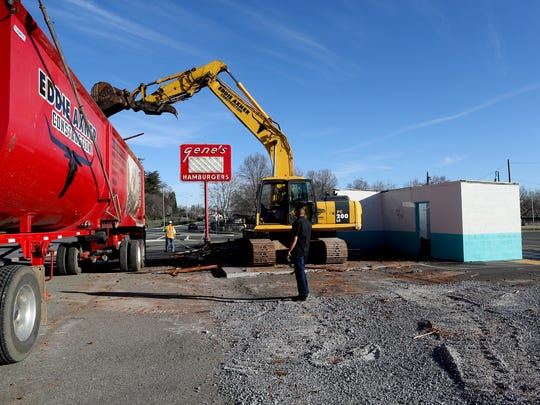 Crews from Eddie Axner Construction tear down Gene's Drive-In Tuesday on South Market Street in Redding. The hamburger stand, which closed last summer, had been a part of the city's landscape since 1954.