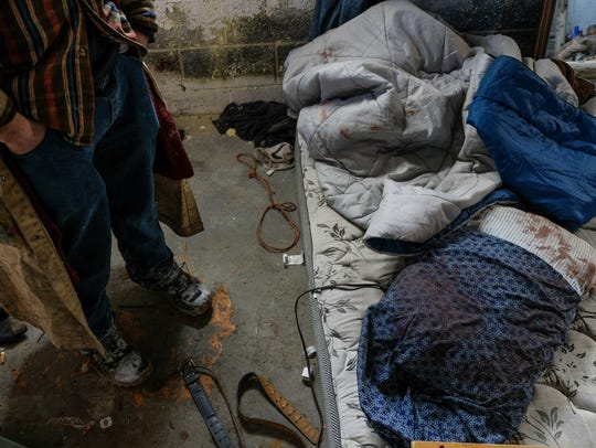 Erick Brown, 31, of Detroit shows rope and bedding